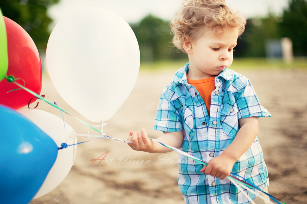 Toddler Boy With Balloons